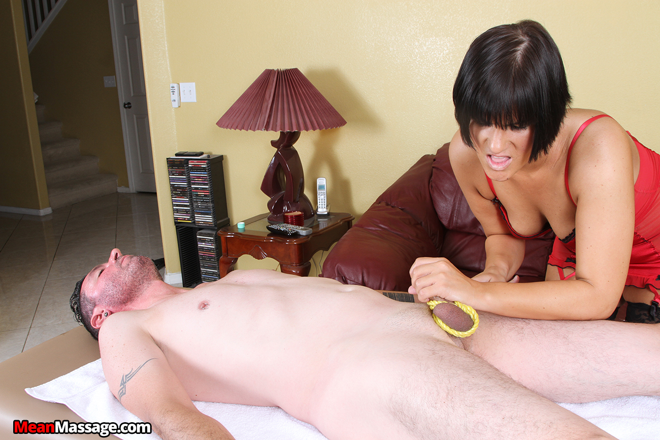 Asian masseuse tugging client during massage 1