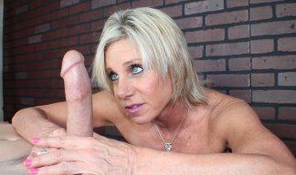 blonde masseuse gives an edging handjob